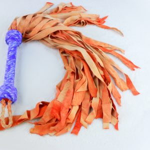 Orange fire fairy flogger with purple mottled roo handle